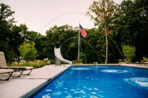 Inground pool with a slide - Zagers Pools Grand Rapids